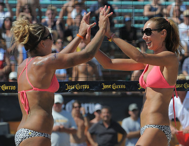 Pavlik and Kropp celebrate thier win in the womens' championship match of the Manhattan Beach Open Sunday. Jenny Kropp and Whitney Pavlik won the title in two games over Tracy Jones and Jennifer Fopma.  Jose Cuervo Pro Beach Volleyball Series. August 28, 2011. Photo by Steve McCrank / Daily Breeze