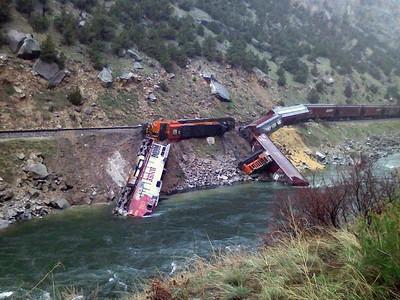 Train Hits Boulder, Tumbles Into River