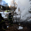 KRISTOPHER RADDER - BRATTLEBORO REFORMER <br /> Crews from the Westminster Fire Department work on putting out the fire at 719 Sweetwood Hill on Wednesday, Jan. 31, 2018. The call came out at 5:05 a.m. for a smoke investigation but upgraded to a first alarm. The icy road slowed vehicles down from reaching the blaze. No injuries were reported and the occupants appeared not be home at the time of the fire.