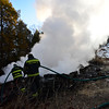 KRISTOPHER RADDER - BRATTLEBORO REFORMER <br /> Westminster Capt. Tim Wilder operates the hose with the help from Lt. Jon Baker while battling a blaze at 719 Sweetwood Hill on Wednesday, Jan. 31, 2018.