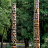 Replicas of two totem poles carved by Bill Holm.  The one on the left is a Tsimshian memorial pole from Northwern British Columbia and the one on the right is a Haida frontal pole from the Queen Charlotte Islands