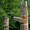 Replicas of two totem poles carved by Bill Holm.  The one on the left is a Tsimshian memorial pole from Northwern British Columbia; the one on the right is a Haida frontal pole from the Queen Charlotte Islands