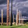 Totems at Kispiox, impending storm