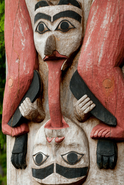 Detail of bottom of pole near entrance to Sitka National Historical Park.
