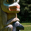 Pole carved by Tlingit Tommy Joseph in 1999 to commemorate Chief K'aylaan, leader of the  Tlingits, in the Tlingit/Russian battle in 1804.  The pole is located on the site of the battleground where the last major Native resistance to Russian dominance took place.  The black raven's head at the bottom of the pole represents the helmet worn by the chief in that battle.