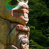 Center of a pole carved by Tlingit Tommy Joseph in 1999 to commemorate Chief K'aylaan, leader of the  Tlingits, in the Tlingit/Russian battle in 1804.  The pole is located on the site of the battle where the last major resistance of Native Americans to Russian dominance took place.  The black raven's head at the bottom of the pole represents the helmet worn by the chief in that battle.