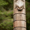 Top of pole located at entrance to the Governor's Walk through the woods at Sitka National Historical Park.