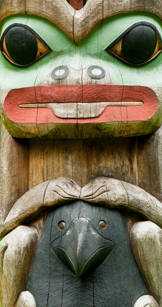 Pole carved by Tlingit Tommy Joseph in 1999 to commemorate Chief K'aylaan, leader of the  Tlingits, in the Tlingit/Russian battle in 1804.  The pole is located on the site of the Tlingit fort.  The black raven's head at the bottom of the pole represents the helmet worn by the chief in that battle.