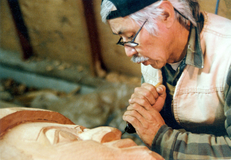 Nathan Jackson carving Honoring Who Give pole in shed behind Totem Heritage Center