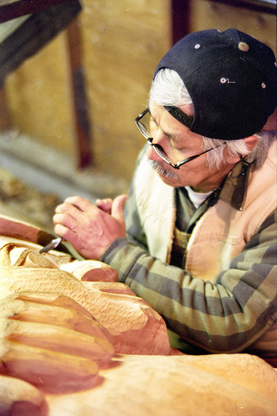 "Nathan Jackson carving ""Honoring Those Who Give"" totem at Totem Heritage Center, October 1998"
