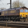 66035 passes Maxey Crossing with 4E26 Dollands Moor - Scunthorpe empty steel