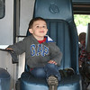 SHEILA SELMAN | THE GOSHEN NEWS<br /> Michael Leighton, 4, Elkhart, enjoys sitting in the chair of an ambulance during Touch-A-Truck at Faith United Methodist Church, north of Goshen, Saturday.