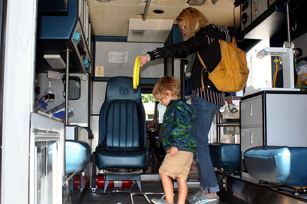 SHEILA SELMAN | THE GOSHEN NEWS<br /> Huxley France, 3, Winona Lake, and mom Courtney France explore the inside of an ambulance Saturday during Touch-A-Truck at Faith United Methodist Churcy, north of Goshen.