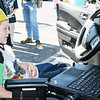 SHEILA SELMAN | THE GOSHEN NEWS<br /> Simon Larson, 8, Elkhart, settles in behind the wheel of an Elkhart County Sheriff's Department car Saturday at Touch-A-Truck at Faith United Methodist Church near Goshen.