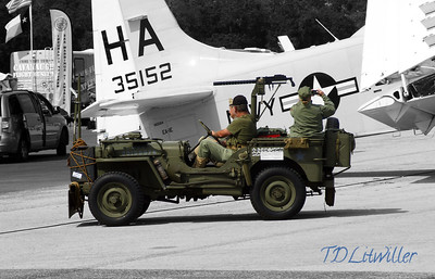 WW2 Jeep beside Douglas A-1E @ Sun n Fun airshow 2013