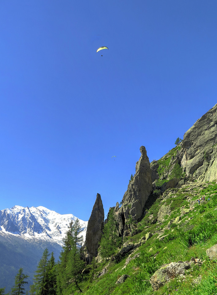 Adrenaline junkies flying their paragliders over the Chamonix Valley