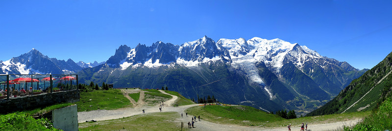 Plan Praz and the Mont Blanc masif.   The paragliders take off from the flat piece of ground just to the right of centre