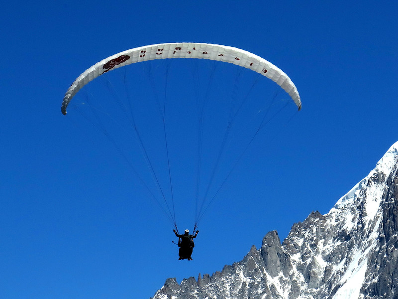 A passing paraglider searches for thermals