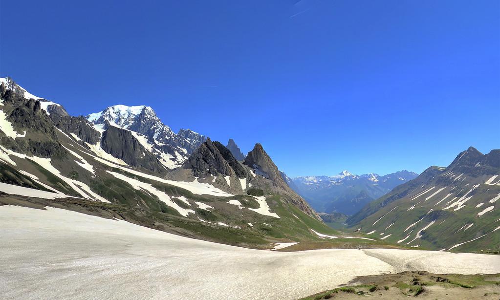 More snow to cross, the view down from Col de la Seigne