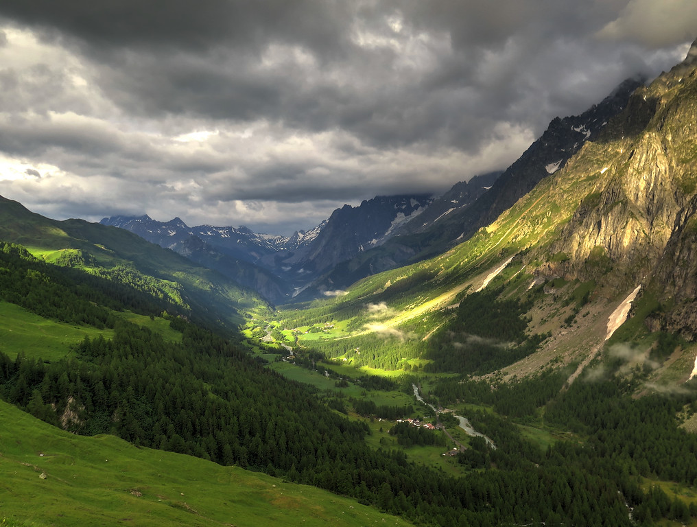 We descended to the valley before the climb up to Grand Col Ferret.   During our coffee stop at Chalet Val Ferret it started to rain and after waiting half an hour for it to stop it didn't so we togged up and resumed our trek up to the Col