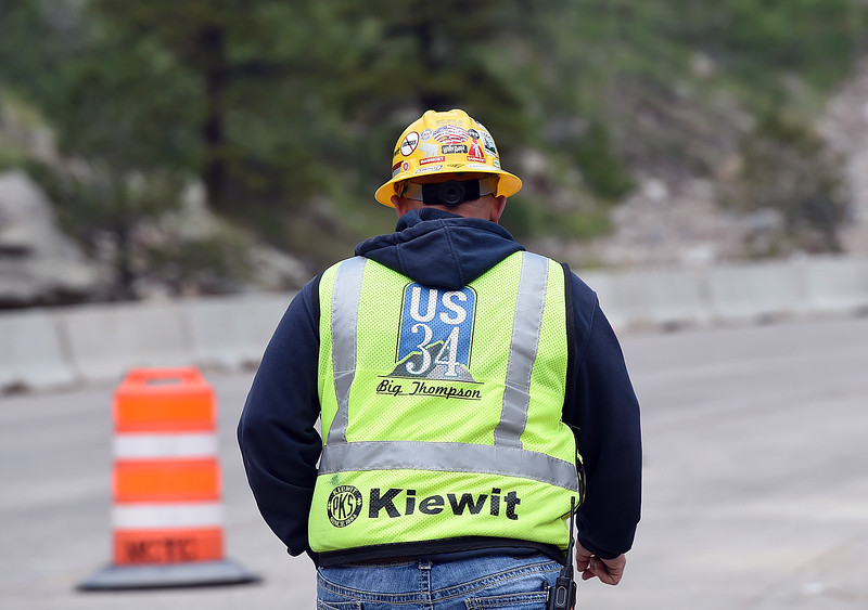 Jason Hagerty, a project manager for Kiewit, wears his U.S. 34 Big Thompson construction vest as crews work on permanent repairs on U.S. 34 in an area called the horseshoe curve Tuesday, May 23, 2017, in the Big Thompson Canyon west of Loveland.   (Photo by Jenny Sparks/Loveland Reporter-Herald)