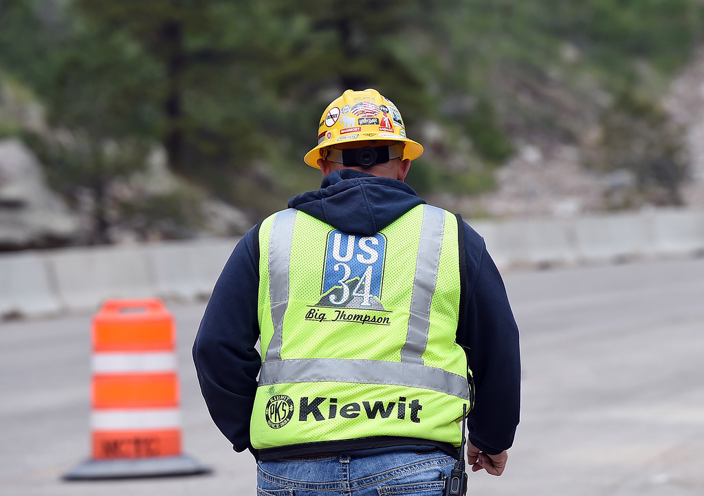 . Jason Hagerty, a project manager for Kiewit, wears his U.S. 34 Big Thompson construction vest as crews work on permanent repairs on U.S. 34 in an area called the horseshoe curve Tuesday, May 23, 2017, in the Big Thompson Canyon west of Loveland.   (Photo by Jenny Sparks/Loveland Reporter-Herald)