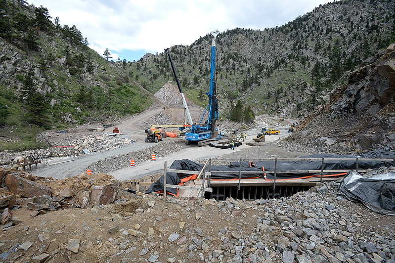 Crews work on permanent repairs on U.S. 34 in an area called the horseshoe curve Tuesday, May 23, 2017, in the Big Thompson Canyon west of Loveland. When work is finished the exhisting road, below, will be moved higher and a bridge will be installed which will take drivers above and over the current road. U.S. 34 will re-open Thursday for the summer.  (Photo by Jenny Sparks/Loveland Reporter-Herald)