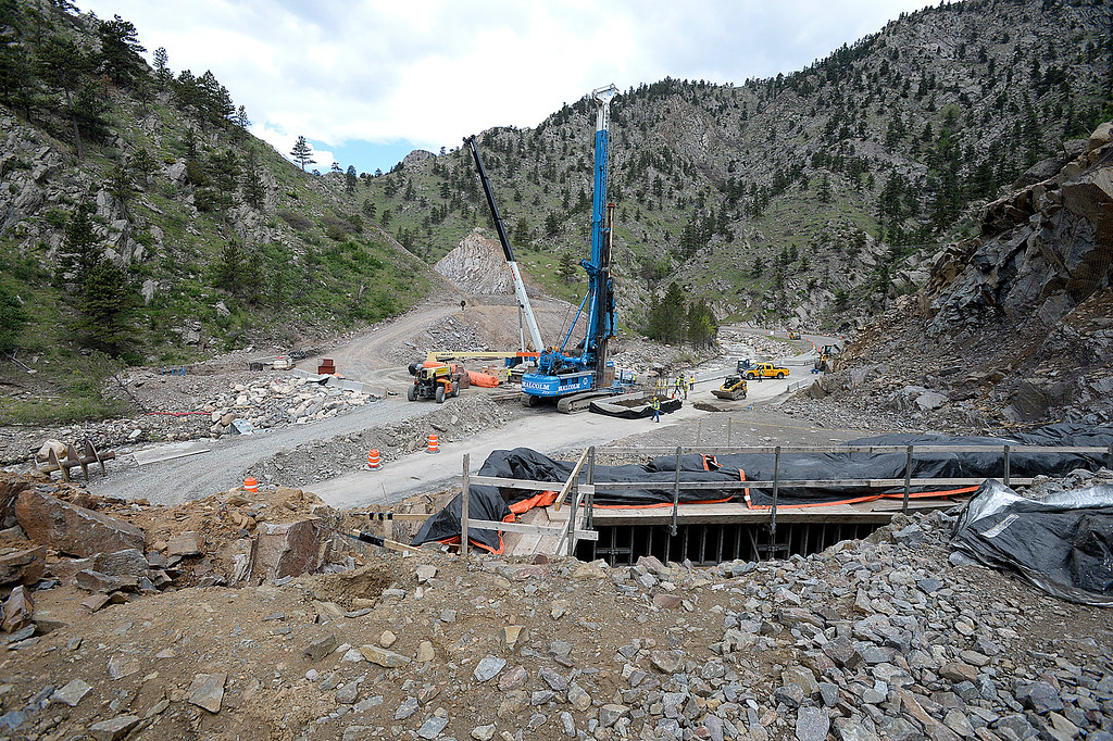 . Crews work on permanent repairs on U.S. 34 in an area called the horseshoe curve Tuesday, May 23, 2017, in the Big Thompson Canyon west of Loveland. When work is finished the exhisting road, below, will be moved higher and a bridge will be installed which will take drivers above and over the current road. U.S. 34 will re-open Thursday for the summer.  (Photo by Jenny Sparks/Loveland Reporter-Herald)