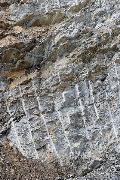 Marks on a rock wall seen Tuesday, May 23, 2017, in the Big Thompson Canyon west of Loveland are from where crews blasted rock while doing permenent repairs on the flood damaged road.   (Photo by Jenny Sparks/Loveland Reporter-Herald)