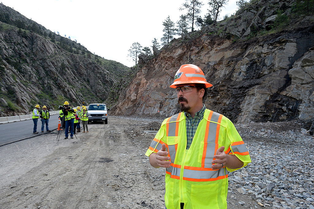 . James Usher, Big Thompson project manager for Colorado Department of Transportation, talks about the rock that was blasted and removed behind him as part of permanent repairs on U.S. 34 in an area called 7M Cut Tuesday, May 23, 2017, in the Big Thompson Canyon west of Loveland.   (Photo by Jenny Sparks/Loveland Reporter-Herald)