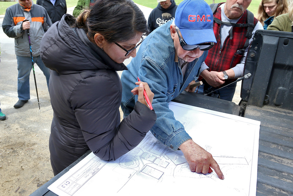 . Purvi Patel, an analyst with Massachusetts Environmental Policy Act (MEPA), listens to the concerns of resident Joseph Fournier as he points them out on a map of the Game On site in Fitchburg just before a tour of the land on Thursday morning April 20, 2017. SENTINEL & ENTERPRISE/JOHN LOVE