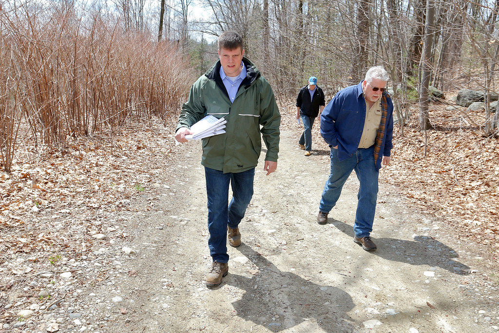. Greg Roy, the project engineer for the Game On site in Fitchburg, and the owner of the land Steve Marsden lead a tour of the land on Thursday morning April 20, 2017. SENTINEL & ENTERPRISE/JOHN LOVE