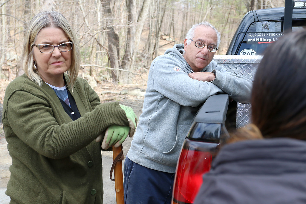 . Resident Sezan Wentworth and owner of Alpha Rho David Tall listen to Purvi Patel, an analyst with Massachusetts Environmental Policy Act (MEPA), as she asks questions of Greg Roy, the project engineer for the Game On site in Fitchburg, just before their tour of the land on Thursday morning April 20, 2017. SENTINEL & ENTERPRISE/JOHN LOVE
