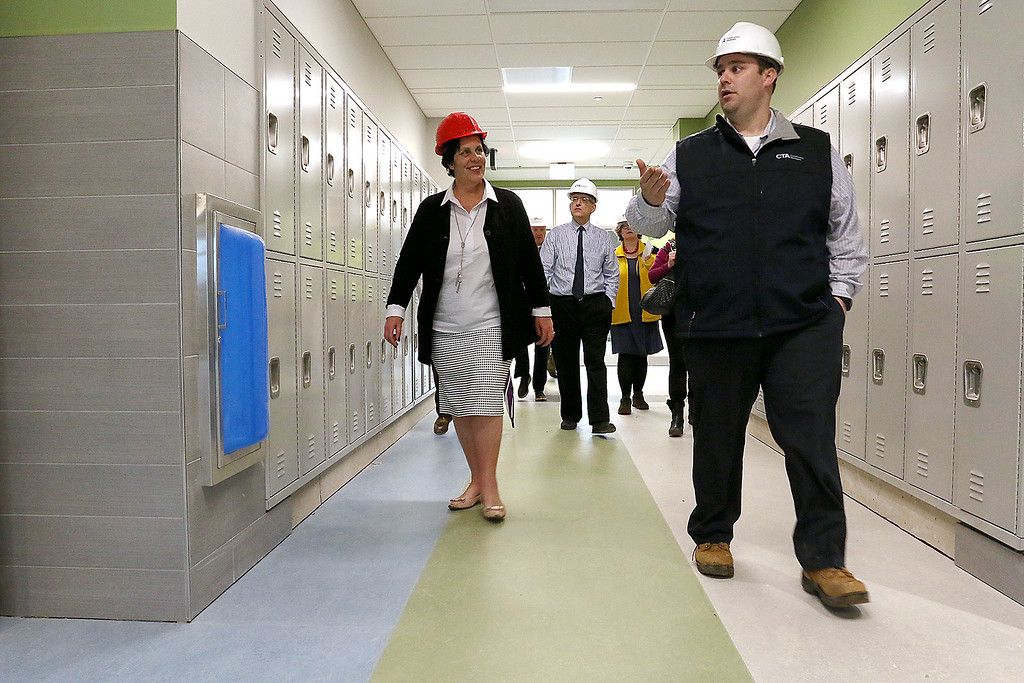 . North Middlesex Regional High School Superintendent Joan Landers listens to Steve Taylor the project executive for CTA as he gives a tour of the new facility on Wednesday April 12, 2017. SUN/JOHN LOVE
