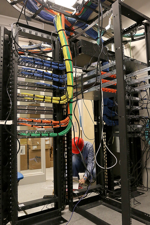 . Stefan Brocoum with integration Partners out of Lexington builds one of the network infrastructure for the new North Middlesex Regional High School on Wednesday April 12, 2017. SUN/JOHN LOVE