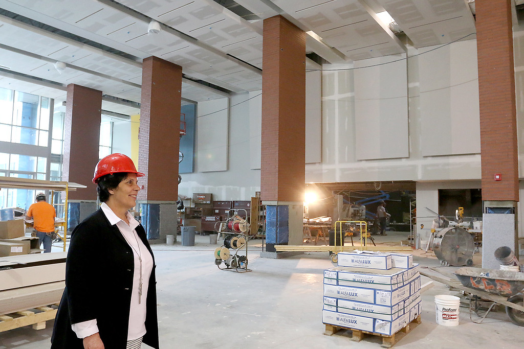 . Superintendent Joan Landers gets a look at the cafeteria of the new North Middlesex Regional High School in Townsend on Wednesday April 12, 2917. There was still a lot of work to do in this area. SUN/JOHN LOVE
