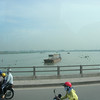 Four to this motor cycle crossing the Saigon River