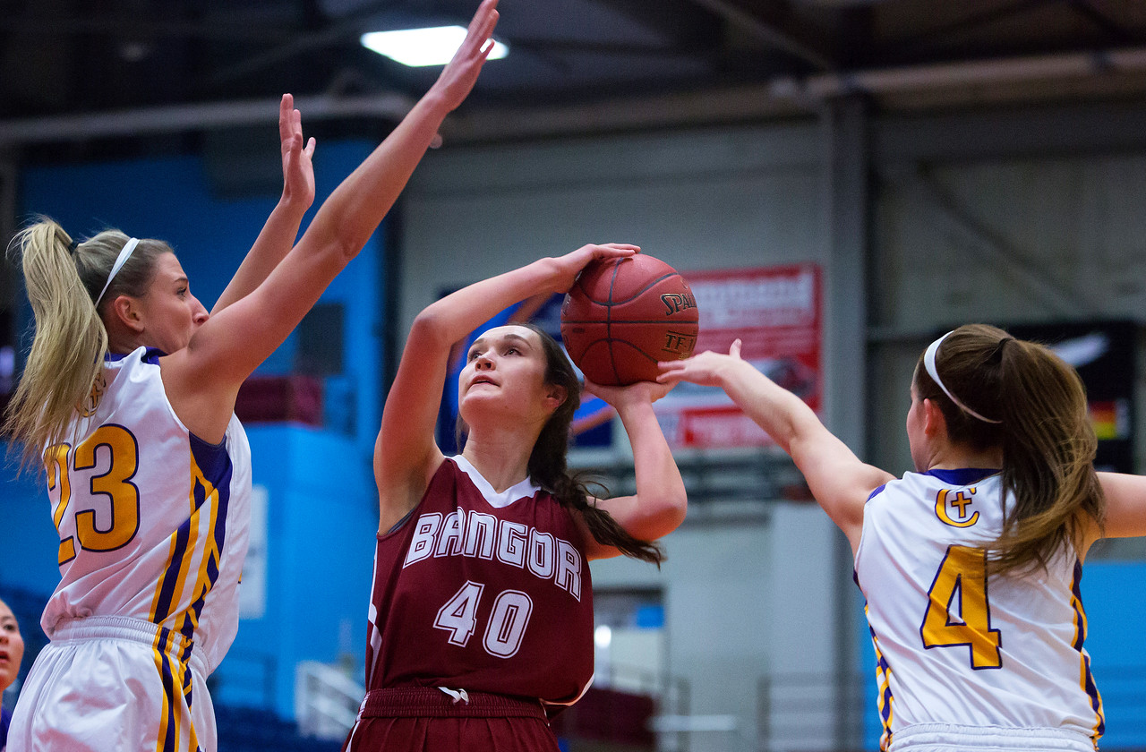 AUGUSTA, Maine -- 02/16/2017 -- Bangor's Katie Butler (center) goes up for two past Cheverus' Brooke McElman (left) and Kaylin Malmquist during their Class AA girls basketball quarterfinal game at Augusta Civic Center in Augusta Thursday. Ashley L. Conti | BDN