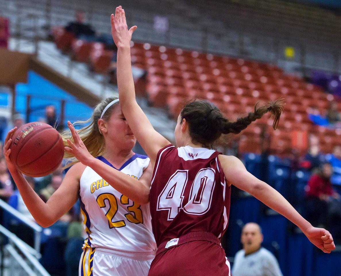 AUGUSTA, Maine -- 02/16/2017 -- Cheverus' Brooke McElman (left) gets a pass around Bangor's Katie Butler during their Class AA girls basketball quarterfinal game at Augusta Civic Center in Augusta Thursday. Ashley L. Conti | BDN