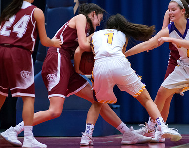 AUGUSTA, Maine -- 02/16/2017 -- Bangor's Katie Butler (left) battles for a rebound against Cheverus' Alayna Briggs during their Class AA girls basketball quarterfinal game at Augusta Civic Center in Augusta Thursday. Ashley L. Conti | BDN