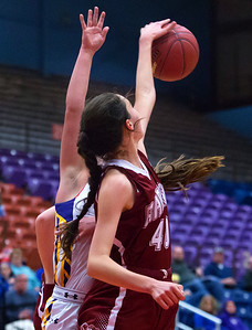 AUGUSTA, Maine -- 02/16/2017 -- Bangor's Katie Butler (right) blocks a shot from Cheverus' Abby Cavallaro during their Class AA girls basketball quarterfinal game at Augusta Civic Center in Augusta Thursday. Ashley L. Conti | BDN