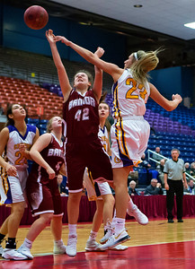 AUGUSTA, Maine -- 02/16/2017 -- Cheverus' Brooke McElman (right) blocks a shot from Bangor's Abby Houghton during their Class AA girls basketball quarterfinal game at Augusta Civic Center in Augusta Thursday. Ashley L. Conti | BDN