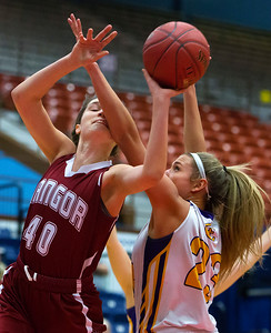 AUGUSTA, Maine -- 02/16/2017 -- Bangor's Katie Butler (left) is fouled by Cheverus' Brooke McElman during their Class AA girls basketball quarterfinal game at Augusta Civic Center in Augusta Thursday. Ashley L. Conti | BDN