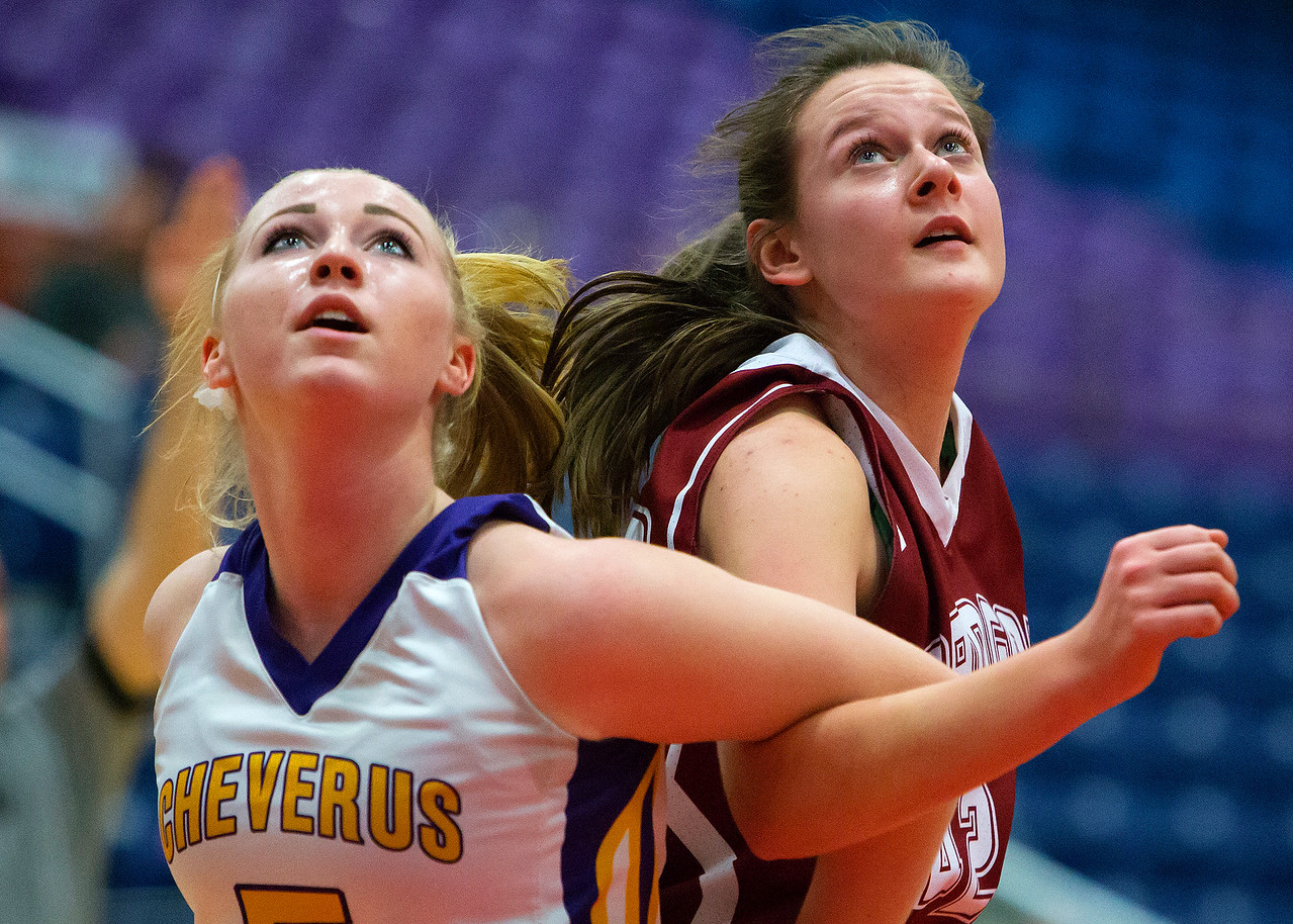 AUGUSTA, Maine -- 02/16/2017 -- Cheverus' Michaela Jordan (left) and Bangor's Abby Houghton wait to see if a free throw drops during their Class AA girls basketball quarterfinal game at Augusta Civic Center in Augusta Thursday. Ashley L. Conti | BDN