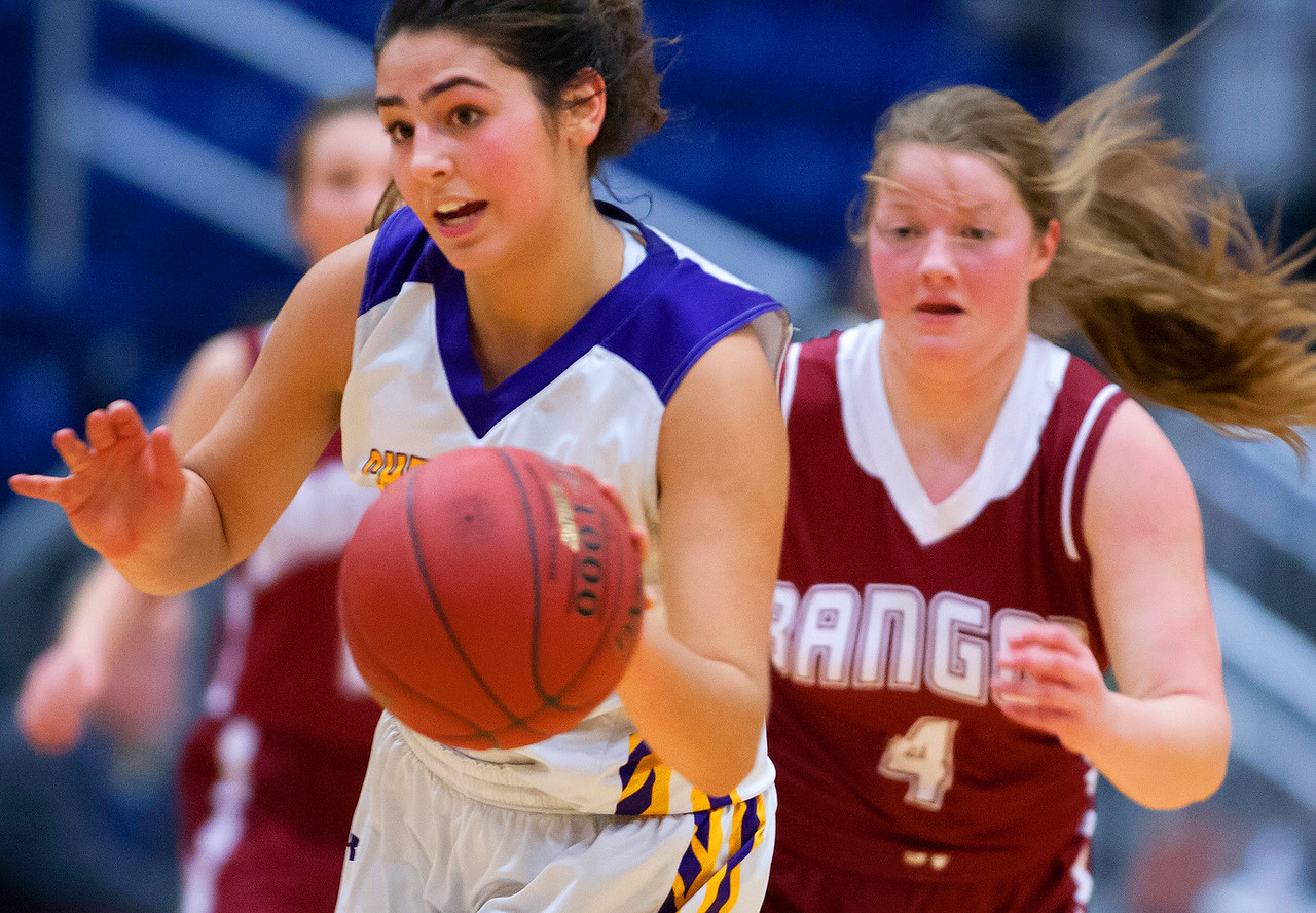 AUGUSTA, Maine -- 02/16/2017 -- Cheverus' Emmme Poulin (left) steals the ball from Bangor's Megan Conner during their Class AA girls basketball quarterfinal game at Augusta Civic Center in Augusta Thursday. Ashley L. Conti | BDN