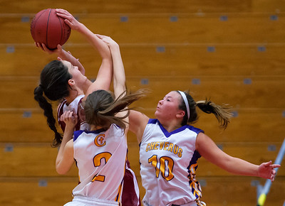 AUGUSTA, Maine -- 02/16/2017 -- Bangor's Katie Butler (left) is fouled by Cheverus' Isabel Dawson (center) while teammate Allison Tillotson provides defense during their Class AA girls basketball quarterfinal game at Augusta Civic Center in Augusta Thursday. Ashley L. Conti | BDN