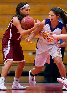 AUGUSTA, Maine -- 02/16/2017 -- Bangor's Samantha Thayer (left) and Cheverus' Emmme Poulin battle for a loose ball during their Class AA girls basketball quarterfinal game at Augusta Civic Center in Augusta Thursday. Ashley L. Conti | BDN