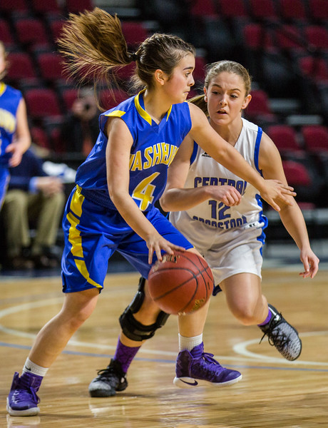 Washburn's Skylar Mette pushes past Central Aroostook's Kelsey Dominique during their game at the Cross Insurance Center in Bangor on Monday morning. Micky Bedell | BDN