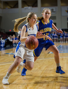 Central Aroostook's Katelyn Levesque (left) pushes past Washburn's Alexis Carney during their game at the Cross Insurance Center in Bangor on Monday morning. Micky Bedell | BDN
