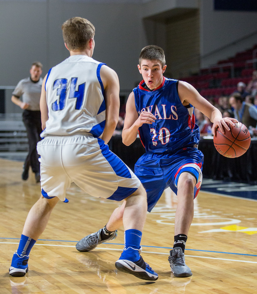 BANGOR, ME -- 02/20/2017 -- Jonesport-Beals' Kaiden Crowley (right) goes to dribble past Central Aroostook's Colby Kingsbury during their Class D quarterfinal game at the Cross Insurance Center in Bangor on Monday afternoon. Micky Bedell | BDN